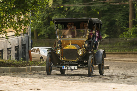 Lviv, Ukraine - June 3, 2018:Old retro car Ford T its owner and an unknown passenger taking participation in race Leopolis grand prix 2018, Ukraine. Sajtókép