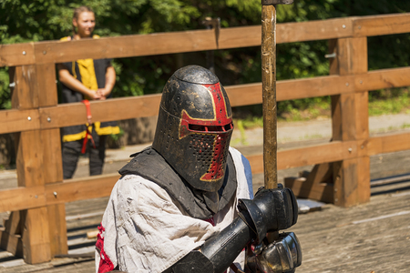 Lviv , Ukraine – august , 04, 2018:  Festival of medieval history and knight duels in the city park in Lviv.Portrait of a knight during a duel