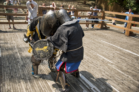 Lviv , Ukraine – august , 04, 2018:  Festival of medieval history and knight duels in the city park in Lviv.Knights fight in group battles Editorial