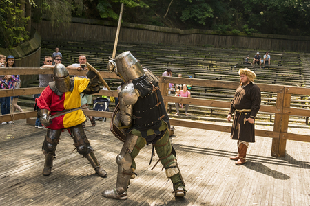 Lviv , Ukraine � august , 04, 2018:  Festival of medieval history and knight duels in the city park in Lviv.Knights fight in group battles