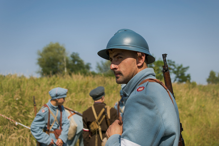 Lviv , Ukraine –  September,03, 2018: Military historical reconstruction is dedicated to the centenary of the proclamation of the Western Ukrainian Peoples Republic. Participants prepare for battle in the city park of the city of Lviv. Editorial