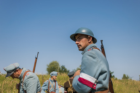 Lviv , Ukraine –  September,03, 2018: Military historical reconstruction is dedicated to the centenary of the proclamation of the Western Ukrainian Peoples Republic. Participants prepare for battle in the city park of the city of Lviv.