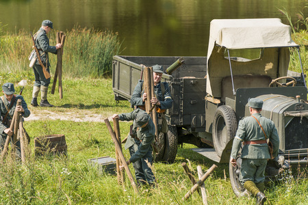 Lviv, Ukraine –  September,03, 2018: Military historical reconstruction is dedicated to the centenary of the proclamation of the Western Ukrainian Peoples Republic in the  park of Lviv city.Sagittarians equip the line of defense Editorial