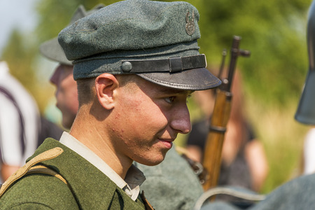 Lviv, Ukraine –  September,03, 2018: Military historical reconstruction is dedicated to the centenary of the proclamation of the Western Ukrainian Peoples Republic in the  park of Lviv city. Portrait of a reconstruction participant in Polish uniform.