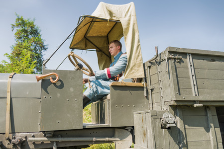 Lviv, Ukraine –  September,03, 2018: Military historical reconstruction is dedicated to the centenary of the proclamation of the Western Ukrainian Peoples Republic in the  park of Lviv city.Unknown driver in Polish uniform in the cabin of a retro truck Editorial