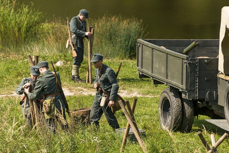 Lviv, Ukraine –  September,03, 2018: Military historical reconstruction is dedicated to the centenary of the proclamation of the Western Ukrainian Peoples Republic in the  park of Lviv city.Sagittarians equip the line of defense