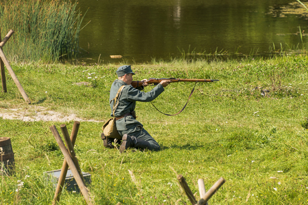 Lviv, Ukraine –  September,03, 2018: Military historical reconstruction is dedicated to the centenary of the proclamation of the Western Ukrainian Peoples Republic in the  park of Lviv city.Sagittarius fires on the enemy