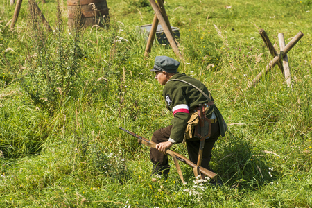 Lviv, Ukraine –  September,03, 2018: Military historical reconstruction is dedicated to the centenary of the proclamation of the Western Ukrainian Peoples Republic in the  park of Lviv city. Polish volunteer is preparing to attack Editorial