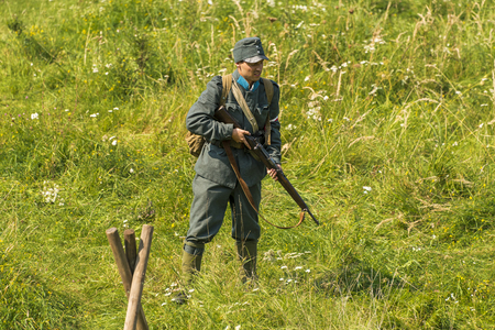 Lviv, Ukraine –  September,03, 2018: Military historical reconstruction is dedicated to the centenary of the proclamation of the Western Ukrainian Peoples Republic in the  park of Lviv city. Sagittarius watches the post.