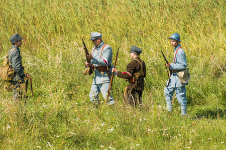 Lviv, Ukraine –  September,03, 2018: Military historical reconstruction is dedicated to the centenary of the proclamation of the Western Ukrainian Peoples Republic in the  park of Lviv city. Polish soldiers and volunteers prepare for defense. Editorial