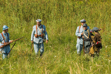 lLviv, Ukraine –  September,03, 2018: Military historical reconstruction is dedicated to the centenary of the proclamation of the Western Ukrainian Peoples Republic in the  park of Lviv city. Polish soldiers and volunteers prepare for defense. Editorial