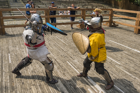 Lviv,Ukraine – august ,04, 2018:  Festival of medieval history and knight duels in the city park in Lviv.Knights fight in group battles Editorial
