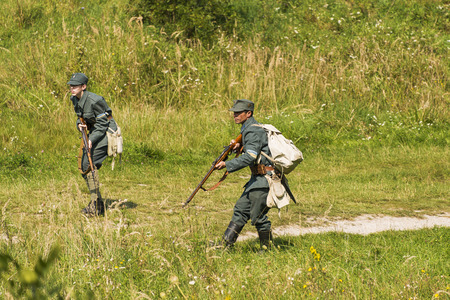 Lviv, Ukraine –  September,03, 2018: Military historical reconstruction is dedicated to the centenary of the proclamation of the Western Ukrainian Peoples Republic in the  park of Lviv city. Sagittarians fires on the enemy.