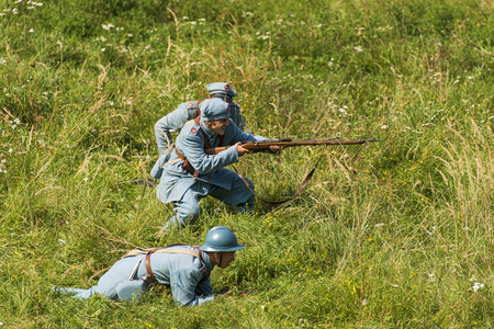 Lviv, Ukraine –  September,03, 2018: Military historical reconstruction is dedicated to the centenary of the proclamation of the Western Ukrainian Peoples Republic in the  park of Lviv city. Polish soldiers  prepare for defense. Editorial
