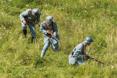 Lviv, Ukraine –  September,03, 2018: Military historical reconstruction is dedicated to the centenary of the proclamation of the Western Ukrainian Peoples Republic in the  park of Lviv city. Polish soldiers and volunteers prepare for defense.