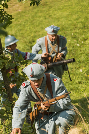 Lviv, Ukraine –  September,03, 2018: Military historical reconstruction is dedicated to the centenary of the proclamation of the Western Ukrainian Peoples Republic in the  park of Lviv city. The soldiers of the Polish army on the march. Editorial