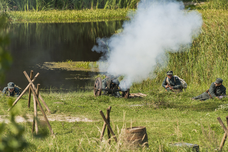 Lviv , Ukraine –  September,03, 2018: Military historical reconstruction is dedicated to the centenary of the proclamation of the Western Ukrainian Peoples Republic. Gunners are preparing to shoot in the city park of the city of Lviv.