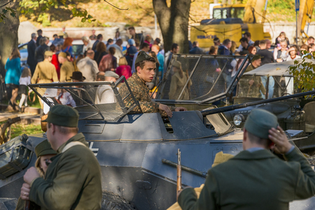 Lviv, Ukraine – Oktober,14, 2018: Military historical reconstruction is dedicated to The anniversary of the creation of the Ukrainian Insurgent Army. Participants prepare for battle in the city park of the city of Lviv.