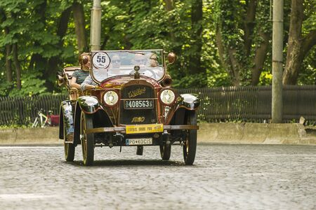 Lviv, Ukraine - June 2, 2019: Old retro car Willys Knight (1920)  with its owner and  unknown passenger taking participation in race Leopolis grand prix 2019, Ukraine. Editorial