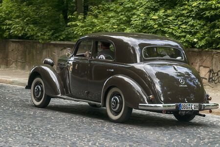 Lviv, Ukraine - June 2, 2019: Old retro car Mercedes Benz 170 S-S with its owner and  unknown passenger taking participation in race Leopolis grand prix 2019, Ukraine.