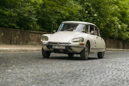 Lviv, Ukraine - June 2, 2019: Old retro car Citroen DS (1970) with its owner and  unknown passenger taking participation in race Leopolis grand prix 2019, Ukraine.