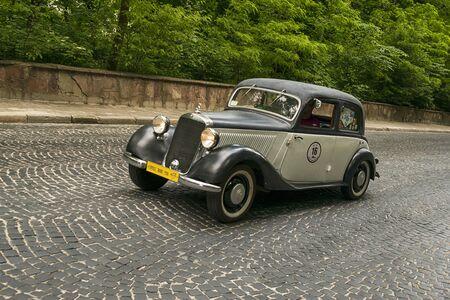 Lviv, Ukraine - June 2, 2019: Old retro car Mercedes- Benz w136 170v (1941)  with its owner and  unknown passenger taking participation in race Leopolis grand prix 2019, Ukraine.