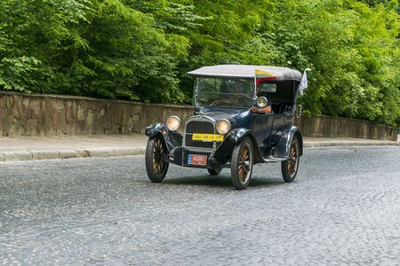 Lviv, Ukraine - June 2, 2019: Old retro car Dodge Brothers (1922)  with its owner and  unknown passenger taking participation in race Leopolis grand prix 2019, Ukraine.