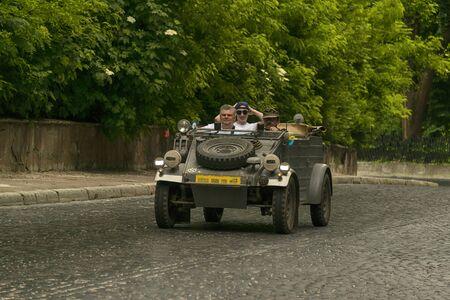Lviv, Ukraine - June 2, 2019: Old retro car Kubelwagen typ 82 with its owner and  unknown passenger taking participation in race Leopolis grand prix 2019, Ukraine.
