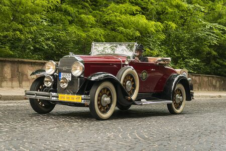 Lviv, Ukraine - June 2, 2019: Old retro car  Buick 1928 with its owner and  unknown passenger taking participation in race Leopolis grand prix 2019, Ukraine.