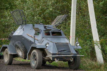 Lviv, Ukraine - October, 14, 2020: Military historical reconstruction is dedicated to the anniversary of the creation of the armed forces. A replica of an armored car is preparing for battle in the vicinity of Lviv.