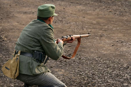 Lviv, Ukraine October, 14 - 2020: Military historical reconstruction is dedicated to the anniversary of the creation of the armed forces. Shooter prepare to shoot in the vicinity of Lviv.