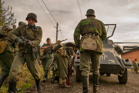 Lviv, Ukraine October, 14 - 2020: Military historical reconstruction is dedicated to the anniversary of the creation of the armed forces. Participants prepare for battle in the vicinity of Lviv.
