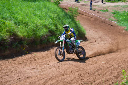Lviv, Ukraine - May 20 2018: Open Cup of Lviv on the motocross track Mayorovka. Unknown motorcycle racer overcomes motocross track in the fight for the championship. Editorial