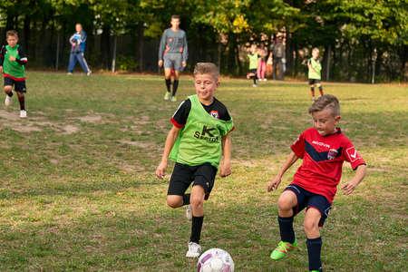 Lviv, Ukraine - 30 Septemberl 2016: Boys playing football on the playground near the school Lviv.
