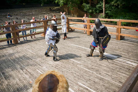 Lviv, Ukraine august, 04,2018: Festival of medieval history and knight duels in the city park in Lviv. Knights fight in group battles.