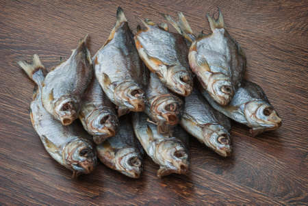 some dried fish on a dark wooden background /