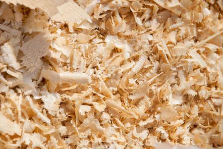 Wood sawdust background closeup. Sawdust floor texture. Top view. Sawdust texture, close-up background of brown sawdust.