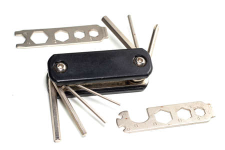 Bicycle multi-function tool with keys and screwdrivers.