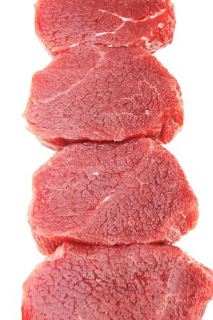 chunks of meat isolated on white background photo