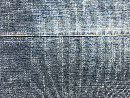 Close up of denimjeans with seam background.