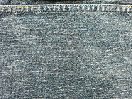 apparel: Close up of denimjeans with seam background.