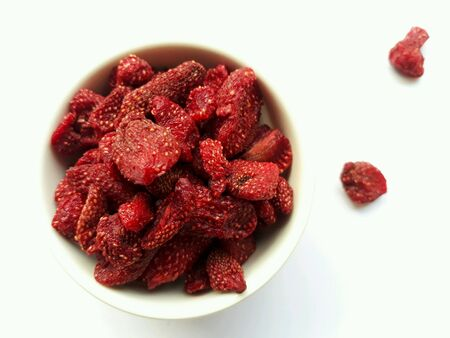 Closeup dried strawberries on white background, selective focus.