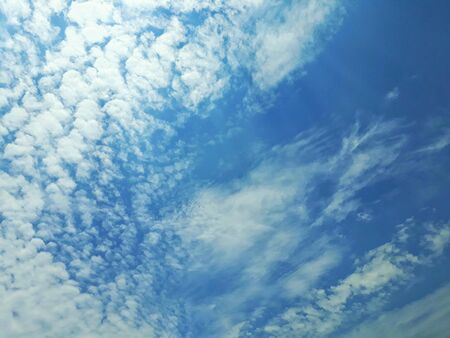 Blue and cloudy sky on sunshine day.
