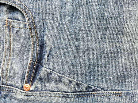 pocket: Closeup dirty denimjeans with seam of the pocket background. Stock Photo