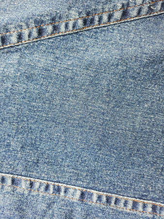 jeans: Closeup dirty denimjeans skirt with seam background.