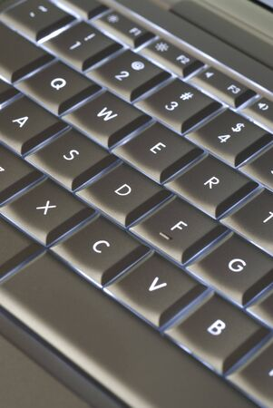 backlit keyboard: Closeup of silver backlit laptop keyboard.