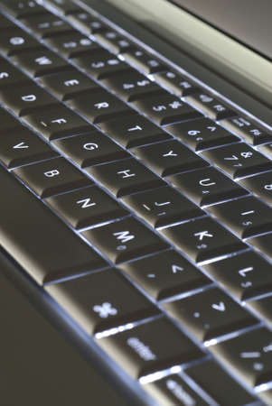 backlit keyboard: Silver keyboard with backlit keys.