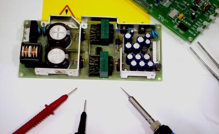 Repair of electronics at the masters workplace 版權商用圖片