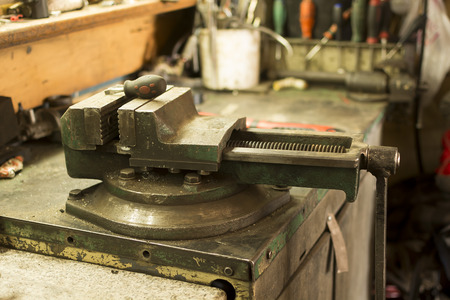 old vices for metal on the desktop in the metal workshop