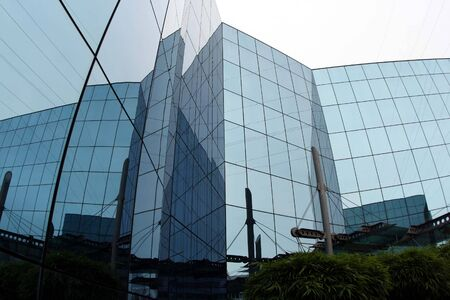 building with front of glass Stock Photo